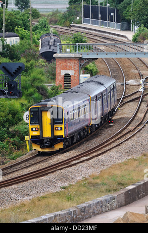 Local passenger train operated by First Great Western approaching Dawlish Warren station - Stock Photo