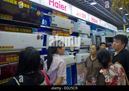 Haier air conditioners are on sale in a Gome electrical appliances store in Beijing, China. 2013 - Stock Photo
