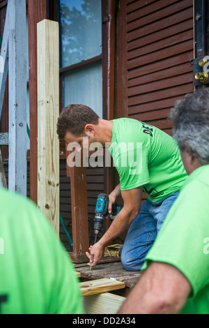 Volunteers participate in community improvement projects in Detroit - Stock Photo