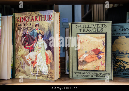 Vintage copies of 'Gulliver's Travels' and 'King Arthur and His Knights' in a secondhand bookshop. - Stock Photo