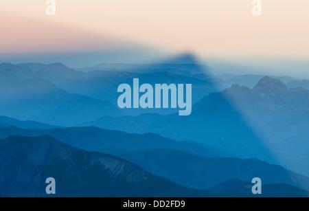 Shadow of the great mountain - Aiguille du Midi over Chamonix-Mont-Blanc valley. Haute-Savoie region, Rhone Alps, - Stock Photo