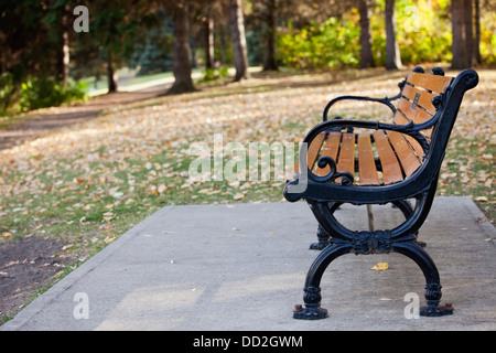 A Wrought Iron Bench With Horizontal Wood Strips In Front