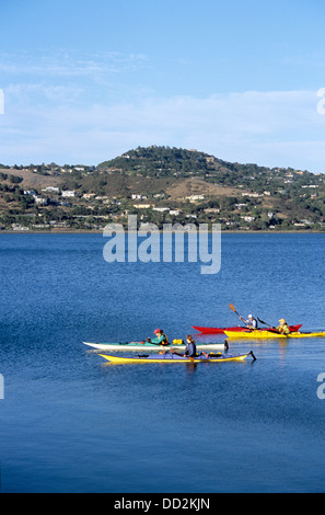 four women friends kayak on Richardson Bay in Marin County - Stock Photo