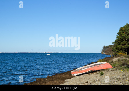 Old fashioned rowing boat at coast - Stock Photo
