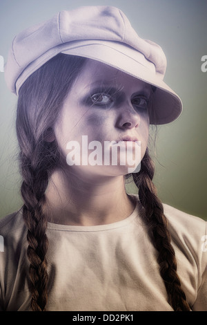 a naughty and dirty girl with a cap - Stock Photo