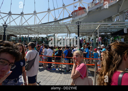Tourists in front of the London Eye, in London - Stock Photo
