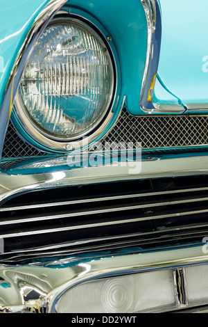 Detail of headlight with chrome grille on a vintage car - Stock Photo