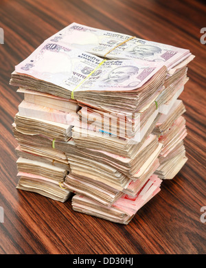 Stack of Indian rupees on a table - Stock Photo