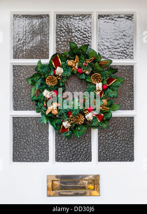 Christmas wreath on front door of a house - Stock Photo