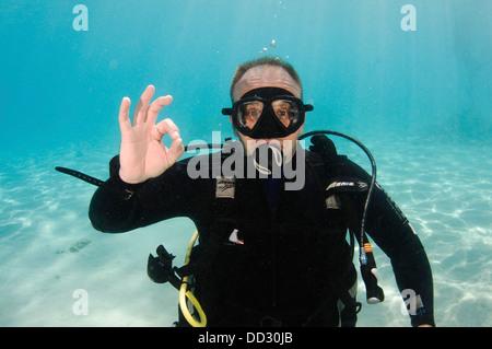 Underwater Hand signs - Stock Photo