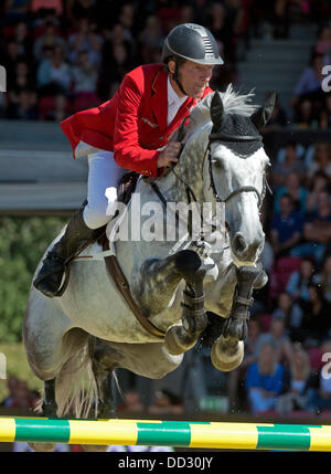 Herning, Denmark. 24th Aug, 2013. German equestrian Ludger Beerbaum performs a jump on his horse Chiara in the first - Stock Photo