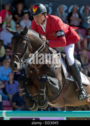 Herning, Denmark. 24th Aug, 2013. German show jumper Christian Ahlmann performs a jump on his horse Codex One in - Stock Photo