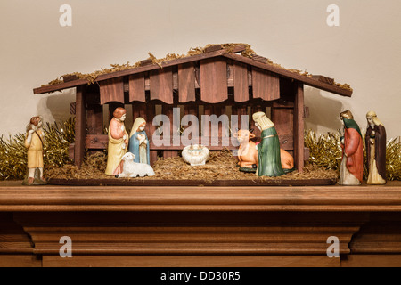 Nativity scene or creche with a stable and manger - Stock Photo
