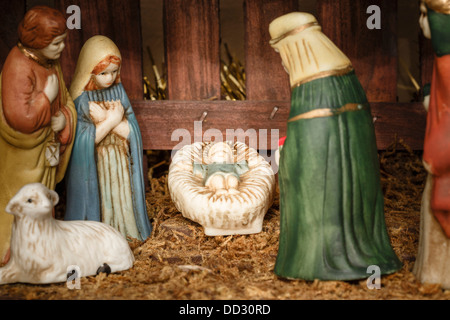 Closeup of figures from a nativity scene or set with Jesus Christ, Mary and Joseph - Stock Photo