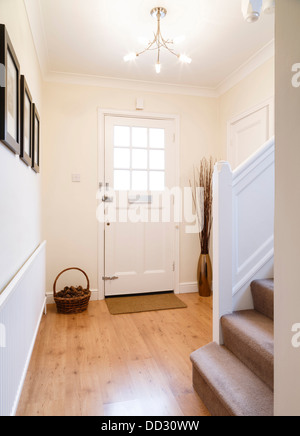 Modern hallway with a wooden floor and radiator - Stock Photo