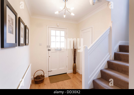 Home interior showing hallway and carpeted stairs - Stock Photo