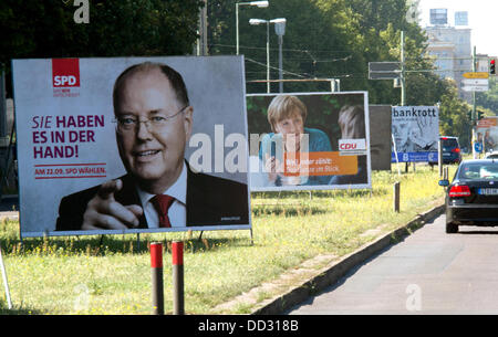 Election posters with SPD chancellor candidate Peer Steinbrueck and chancellor Angela Merkel (CDU) stand at the - Stock Photo