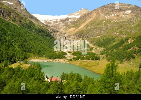 Switzerland - Lago Bianco - from the Bernina Express train - mountain backdrop -  Piz Bernina + Piz Palu  - summer - Stock Photo