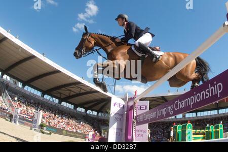 Herning, Denmark. 24th Aug, 2013. British show jumper Scott Brash jumps over a hurdle on his horse Hello Sanctos - Stock Photo