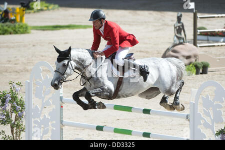 Herning, Denmark. 24th Aug, 2013. German show jumper Ludger Beerbaum performs a jump on Chiara duirng the second - Stock Photo