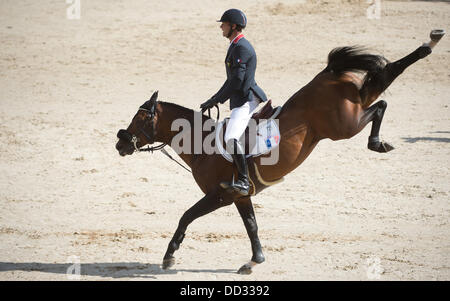 Herning, Denmark. 24th Aug, 2013. French show jumper Aymeric De Ponnat performs a jump on Armitages Boy during the - Stock Photo