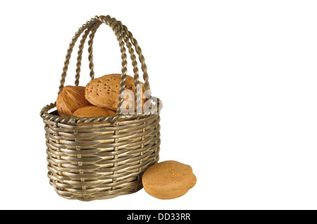 Small metal basket with almonds isolated on white - Stock Photo