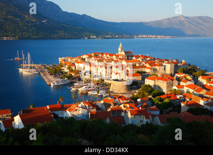 Korcula old town. Peninsula Peljesac in the background. - Stock Photo