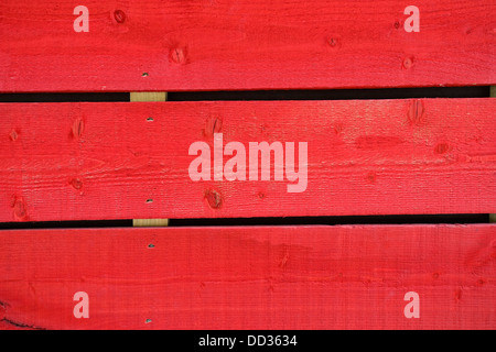 Planks of wood coloured in red - Stock Photo