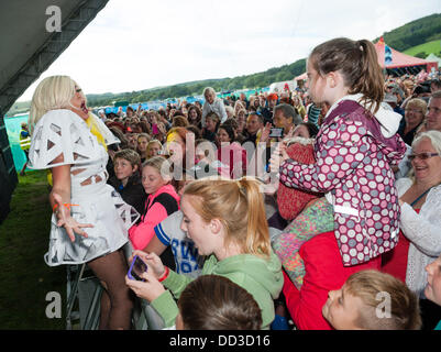 Aberystwyth Wales UK, Saturday 24 August 2013   'Maybe GaGa', a Lady Gaga tribute act, with her fans at The second - Stock Photo