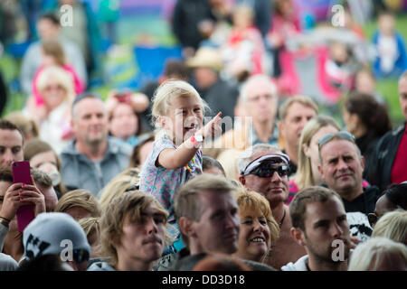 Aberystwyth Wales UK, Saturday 24 August 2013   A happy young child enjoying the music at The second day of the - Stock Photo