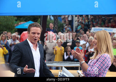 Stefan Mross and Stefanie Hertel are pictured at the live broadcast of the program 'Immer Wieder Sonntags' by broadcaster - Stock Photo
