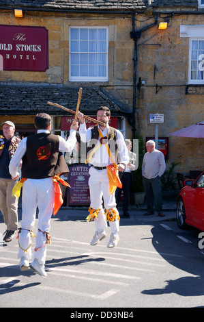 May Day Morris Dancing in the market town of Stow-on-the-Wold in the Cotswolds. - Stock Photo