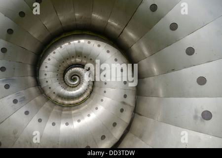 Metal spiral snail sculpture on fields on the edge of Chesterfield town centre UK - Stock Photo