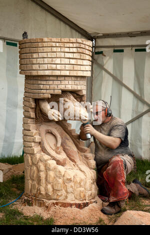Tabley, Cheshire, UK 25th August, 2013. Steven Kenzora from Canada at the 9th English Open Chainsaw Carving Competition, - Stock Photo