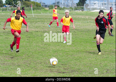 U15B football players running after the ball, Cape Town, South Africa - Stock Photo