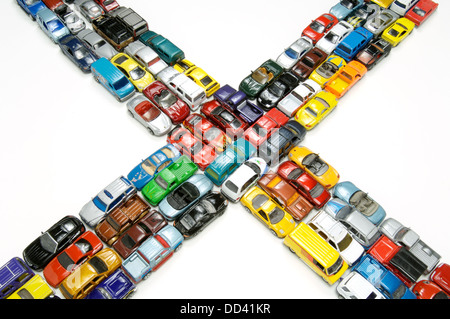 A traffic jam of miniature toy cars at an intersection. - Stock Photo