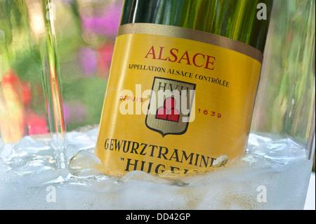 ALFRESCO WINE BUCKET CHILLER 'Hugel' Gewurztraminer white wine bottle in wine cooler in alfresco situation Riquewihr - Stock Photo