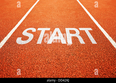 Start on athletics all weather running track - Stock Photo