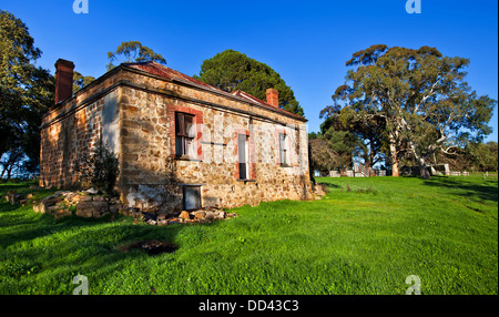 Old abandoned farm house derelict stone homestead winter green grass morning sunlight Meadows Road Fleurieu Peninsula - Stock Photo