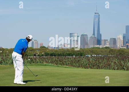 Jersey City, New Jersey, USA. 25th Aug, 2013. August 25, 2013: Sergio Garcia (ESP) chips onto the 14th green in - Stock Photo