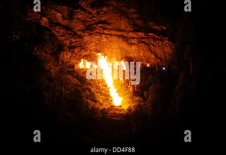 Oberammergau, Germany. 24th Aug, 2013. A fire in the shape of a cross is seen at the Kofel mountain near Oberammergau, - Stock Photo