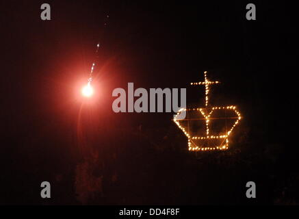 Oberammergau, Germany. 24th Aug, 2013. A fire in the shape of a crown and flares are seen at the Kofel mountain - Stock Photo