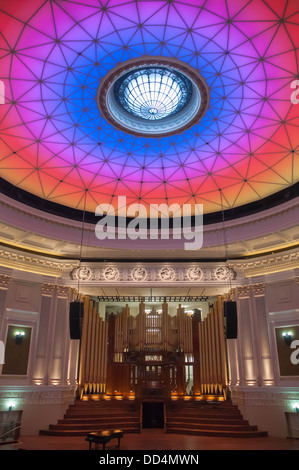 Changing colours of the City Hall auditorium dome, Brisbane, Queensland - Stock Photo