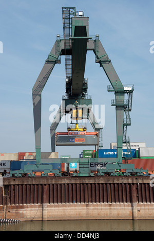 Container terminal beside the river Rhine in Germany - Stock Photo