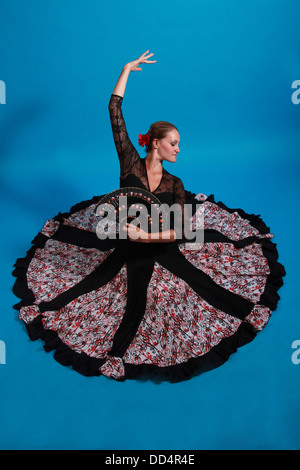 Flamenco dance moves, lady in a black dress with fan - Stock Photo