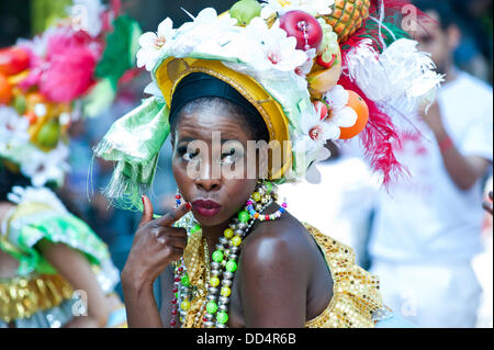 London, UK. 26th Aug, 2013. revellers take part in the annual parade at the Notting Hill Carnival. Credit:  Piero - Stock Photo