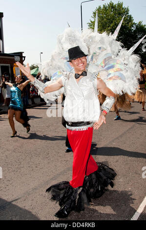 London, UK. 26th Aug, 2013. Performers dancing along the route of the Notting Hill Carnival. Credit:  Pete Maclaine/Alamy - Stock Photo