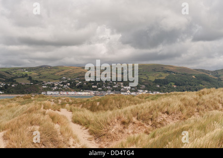 Aberdovey seaside village nestled in the north bank of river Dyfi within Snowdonia National Park foreground sandbanks - Stock Photo