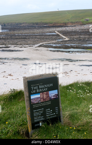A sign for the Brough of Birsay in front of the causeway leading to the island. - Stock Photo
