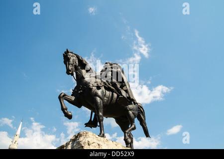 Statue Albanian national hero George Kastrioti Skanderbeg on his horse, in the main square of Tirana, the capital - Stock Photo